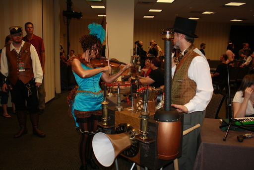A steam-powered music box, and a violinist